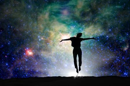 68115622-silhouette-of-a-woman-jumping-starry-night-background.jpg